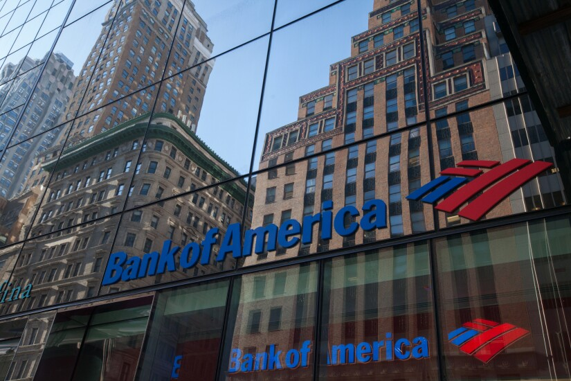 Building are seen reflected on the exterior of a Bank of America branch in New York.
