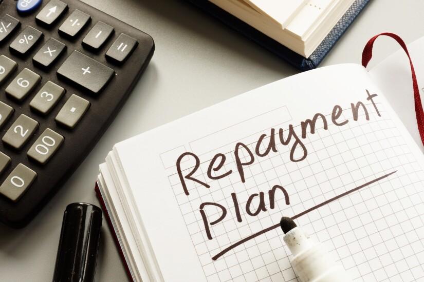Conceptual hand written text showing repayment plan