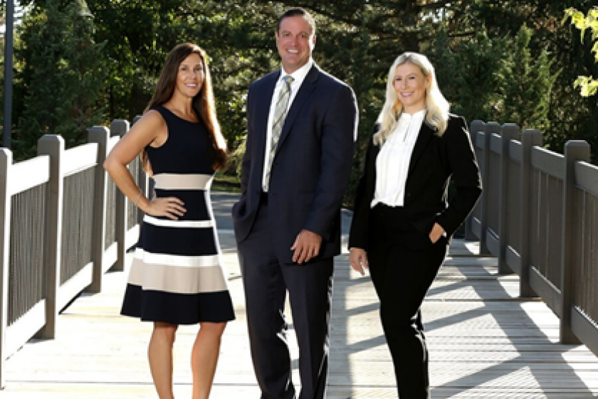 Aggressive recruiting efforts in recent years have boosted Raymond James' headcount to more than 8,000 advisors. Its newest additions advisor Steven LeClair, center, and his teammates Jodi McMillan, left, and Lauren Matthiessen.