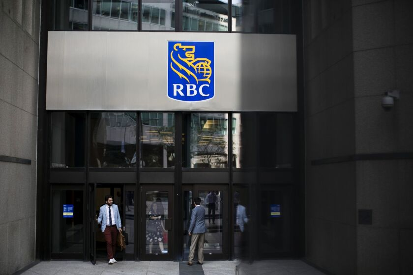 Bay Street As Canada Stocks Retreat As Investors Eschew Pot, Shopify Tumbles People enter and exit from the Royal Bank of Canada (RBC) headquarters in the financial district of Toronto, Ontario, Canada, on Thursday, July 25, 2019. Canadian stocks fell as tech heavyweight Shopify Inc. weighed on the benchmark and investors continued to flee pot companies. Photographer: Brent Lewin/Bloomberg