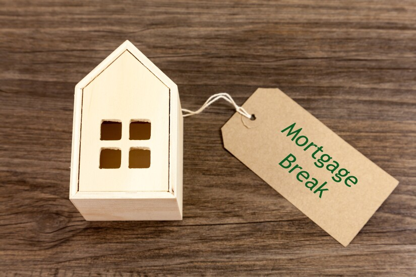 Mortgage Break - Toy wooden house alongside label which reads 'Mortgage Break'