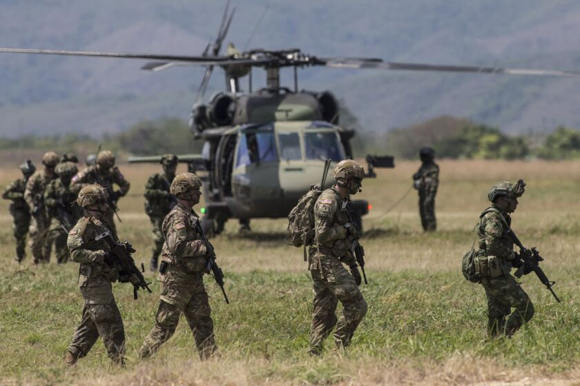 American and Colombian soldiers participate in multinational military exercises at the Tolemaida Air Base in Tolemaida, Colombia, on Sunday, Jan. 26, 2020.