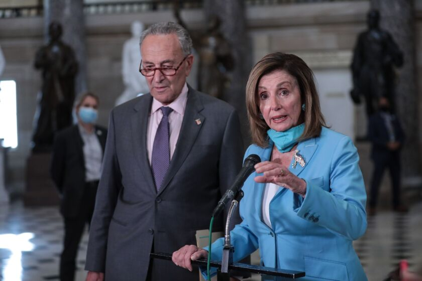 Nancy Pelosi, right, with Chuck Schumer, following a meeting at the U.S. Capitol in Washington, D.C., on Aug. 5.