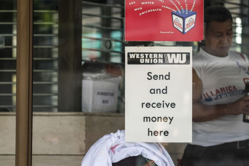 A Western Union sign is displayed at a remittance center during a partial lockdown imposed due to the coronavirus in Quezon City, Metro Manila, the Philippines, on May 20.