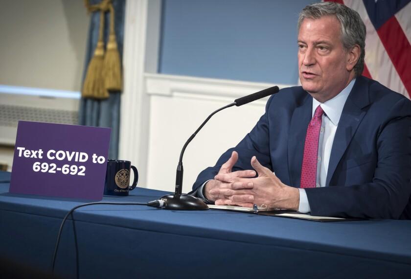 NYC Mayor Bill de Blaisio speaks via remote at City Hall.