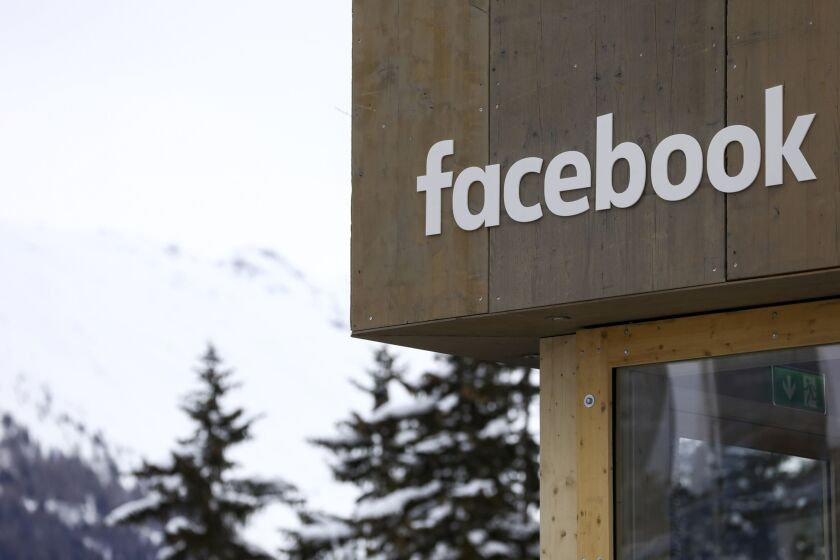 A logo sits on the side of the Facebook pop-up office ahead of the World Economic Forum in Davos, Switzerland, on Jan. 21, 2119.