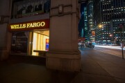 A Wells Fargo bank branch stands at night in New York.