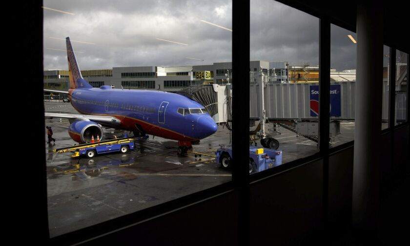 A Southwest aircraft stands on the tarmac at San Francisco International Airport.
