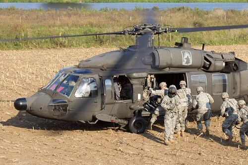 GRAVE, NETHERLANDS - SEP 17: Soldiers of the 82nd Airborne Division enter a Black Hawk helicopter at the Operation Market Garden memorial on Sep 17, 2014 Grave, Netherlands. Market Garden was a large Allied operation in 1944.