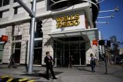 Pedestrians walk past a Wells Fargo bank branch in Los Angeles.