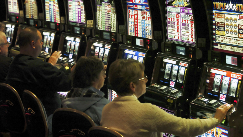Patrons play slot machines at the Mohegan Sun at Pocono Downs in Wilkes-Barre, Pa.