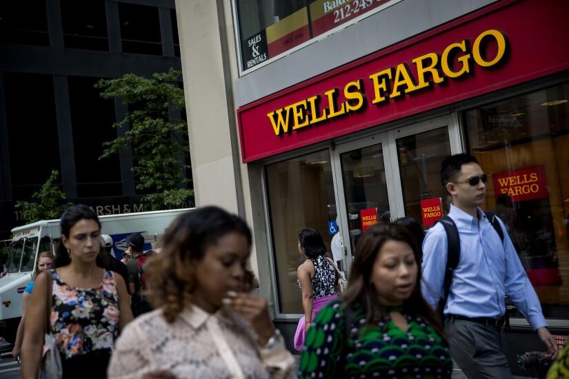Wells Fargo people walking by Bloomberg News