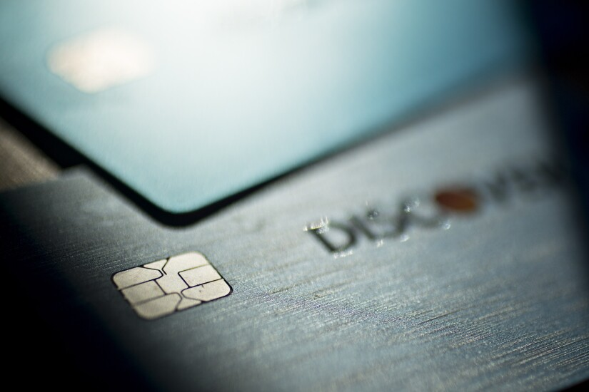Discover Financial Services chip credit and debit cards are arranged for a photograph.