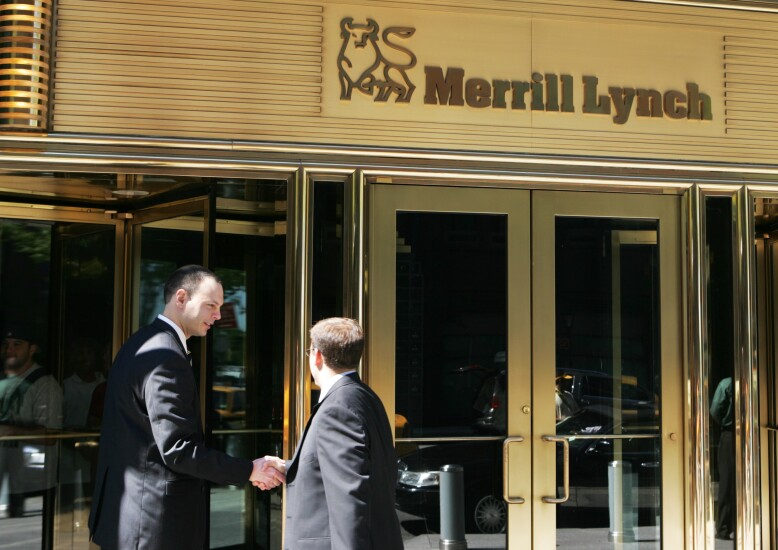 Merrill Lynch By Bloomberg News men shaking hands