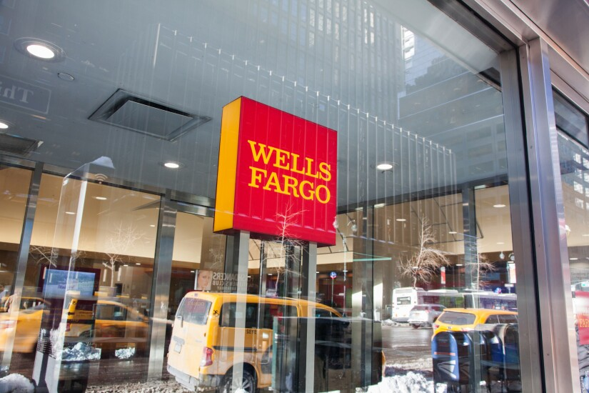 Signage is displayed at a Wells Fargo bank branch in New York.