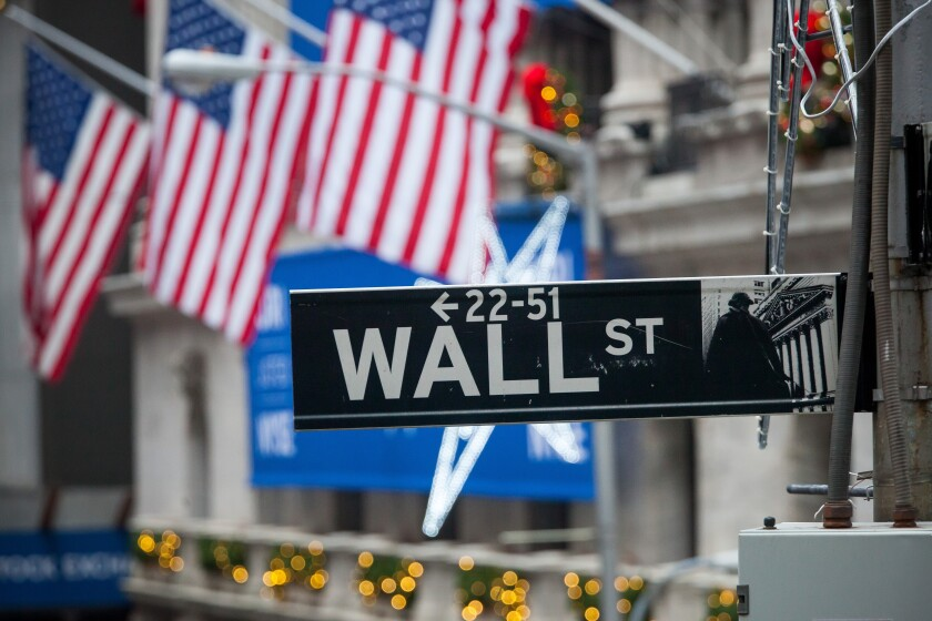 Wall-Street-sign-american-flag-winter-bloomberg