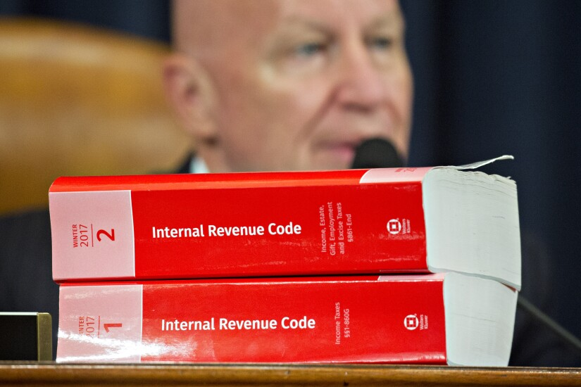GOP tax plan with Rep. Kevin Brady in background