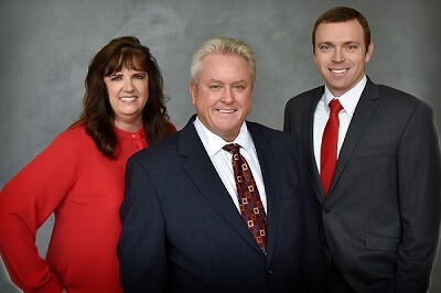 Advisors James Trimpe and Timothy Stolt join Raymond James from Wells Fargo. Left to right: Lori Rupe, James Trimpe, Timothy Stolt