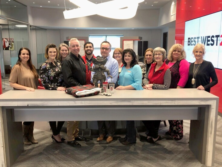 Texas Tech Federal Credit Union's mortgage team (from left to right): Averi Lewis, Crystal Barrett, Susan Daniel, Tom Couture, Alex Ramirez, Jay Herrin, Bridget Robison, Rhonda Bloodworth, Amanda Barnett, Lori Hill, Karen Wallin and Kelly Prayor.