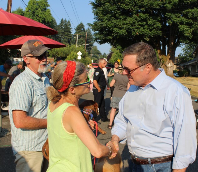 U.S. Rep. Denny Heck (D-Wash.) on the campaign trail. Heck, at right, is a former credit union employee.