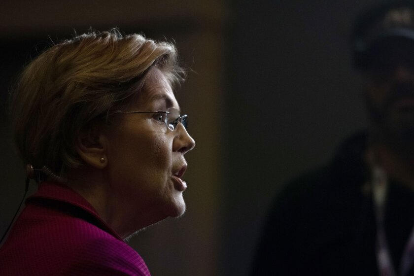 Sen. Elizabeth Warren, D-Mass. and 2020 presidential candidate, speaks to a member of the media following the Democratic presidential candidate debate in Charleston, South Carolina, on Feb. 25, 2020.