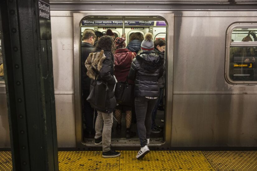 Commuters stand in a crowded L train subway car at the Bedford Avenue station in the Brooklyn borough of New York, U.S., on Thursday, Dec. 21, 2017.