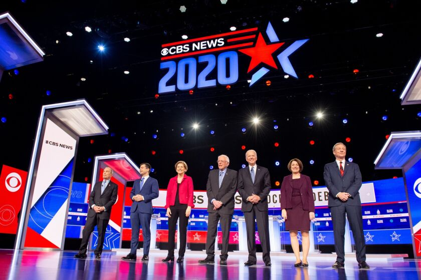 2020 presidential candidates Michael Bloomberg, founder of Bloomberg LP, from left, Pete Buttigieg, former mayor of South Bend, Senator Elizabeth Warren, a Democrat from Massachusetts, Senator Bernie Sanders, an Independent from Vermont, former Vice President Joe Biden, and Senator Amy Klobuchar, a Democrat from Minnesota, and Tom Steyer, cofounder of NextGen Climate Action Committee arrive on stage during the Democratic presidential candidate debate in Charleston, South Carolina.