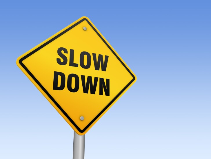slow-down-sign-adobe