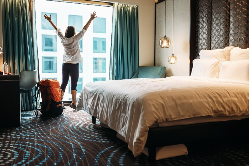 checking-into-hotel-room-121590621-adobe.jpeg