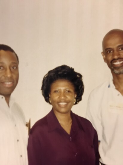 Michael Hale (on the left) poses with Sheilah Montgomery and Hubert Hoosman, three African-American credit union professionals who played a major role in the success of the African-American Credit Union Coalition.