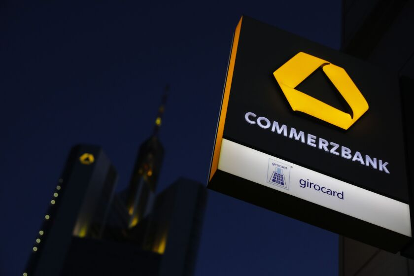 The Commerzbank logo sits illuminated on an ATM sign outside a branch near the bank's headquarters in Frankfurt, Germany, on June 29, 2020.