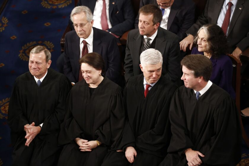 Several justices, including Chief Justice John Roberts, far left, suggested that it could be problematic to establish a new standard for presidential firings since that standard could also be challenged in court.