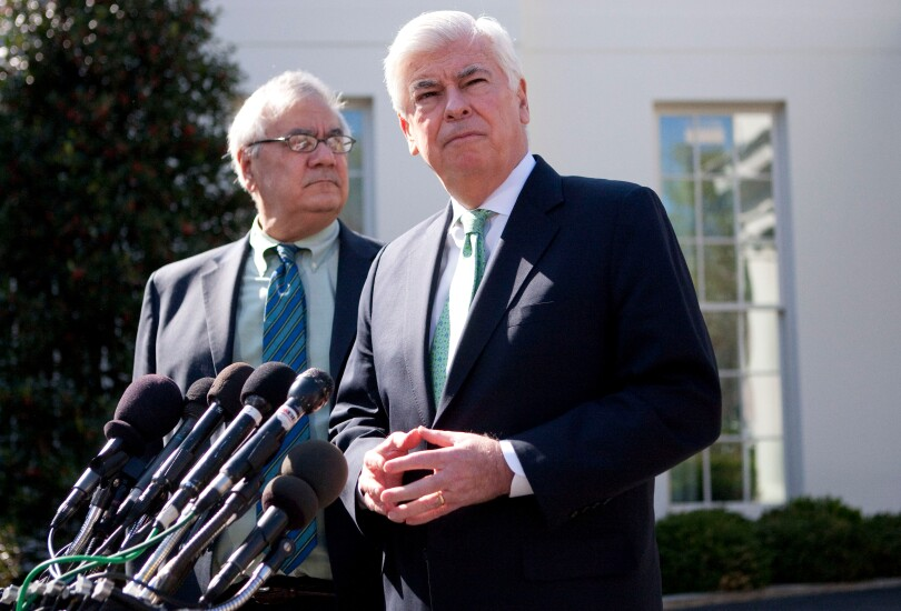 Sen. Chris Dodd, right, speaking at a news conference with Rep. Barney Frank at the White House on March 24, 2010.