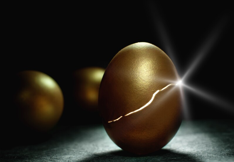 Image of a golden egg cracking open