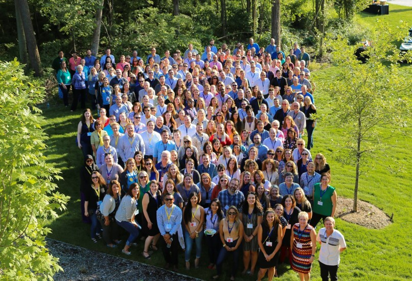 During a picnic in 2018, Consumers CU's 300 employees, including senior management, gather for a photo celebrating the credit union surpassing the $1 billion-asset mark.