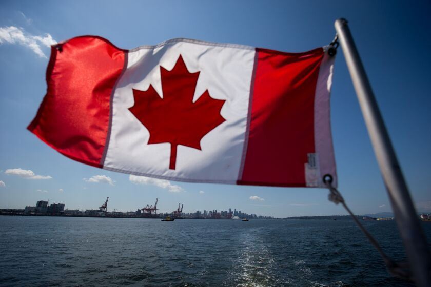 A Canadian flag flies from a Harbour Authority patrol boat