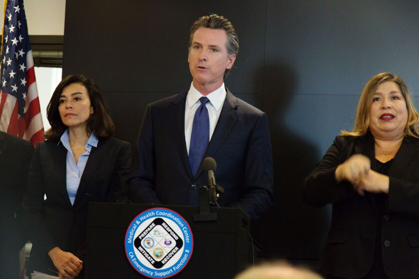 California Gov. Gavin Newsom said he is also asking banks and credit unions to waive ATM and overdraft fees for struggling customers.