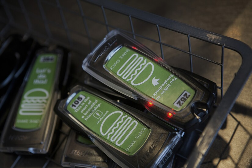 A basket of Shake Shack pagers