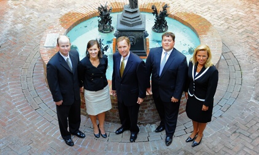 Tommy Boyd (center) says his five-member team, which includes his son and daughter, considered changing its name from Boyd Financial Group when they left Wells Fargo for the independent side of Raymond James. But history weighed on their thinking.