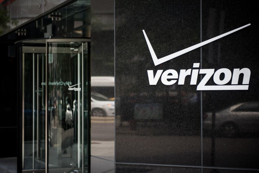 Signage sits on the exterior of a Verizon store in downtown Chicago.