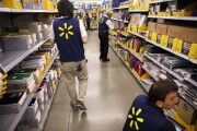 Employees restock shelves of school supplies at a Wal-Mart Stores Inc. location in Burbank, California.