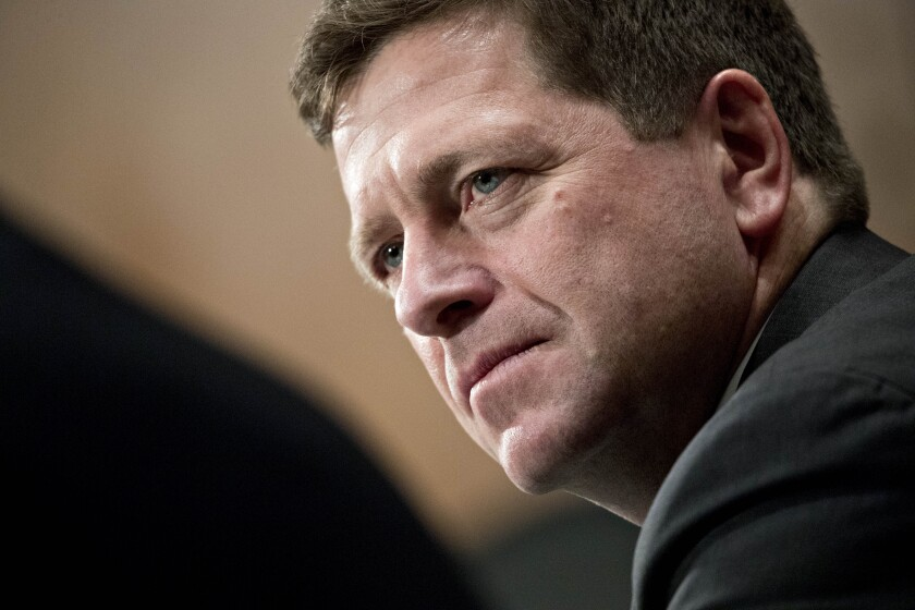 Jay Clayton, chairman of the U.S. Securities and Exchange Commission (SEC), listens during a Senate Banking, Housing and Urban Development Committee hearing in Washington, D.C., U.S., on Tuesday, Feb. 6, 2018