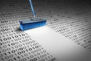 Broom brushing away 0 and 1 data bits.