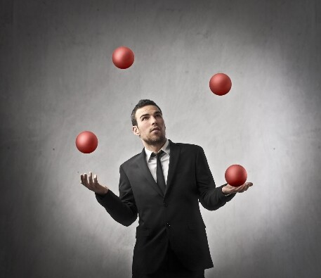 Juggling in a business suit