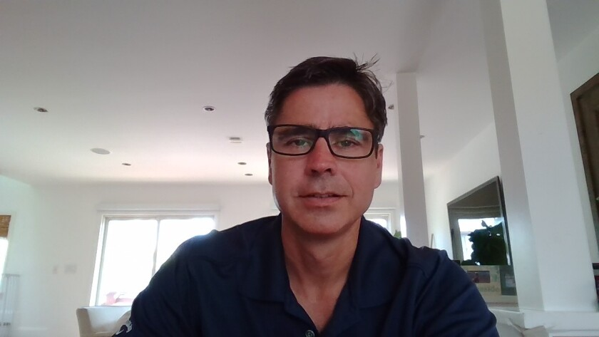 Derek Holman, co-founder of EP Wealth Advisors, mainly works from home like most of his colleagues. His firm may reduce its real estate footprint by 25% in coming years.