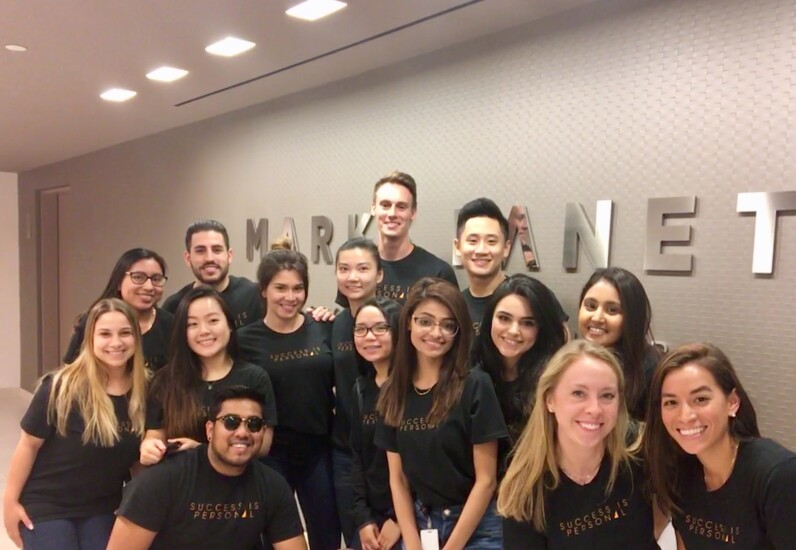 "Marks Paneth employees in New York assembled for a photo when the firm launched its ""Success is Personal"" branding campaign."