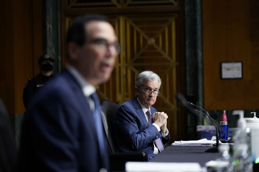 """I find it implausible that any member of this committee believes that in voting for the CARES Act you were authorizing me to invest $500 billion to make loans in perpetuity,"" said Treasury Secretary Steven Mnuchin, left. But Fed Chair Jerome Powell said the central bank would have maintained the programs if Treasury had not requested their termination."