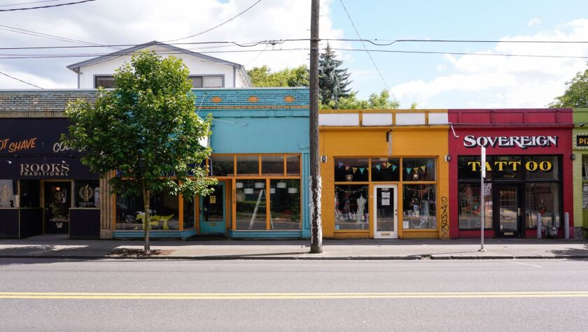 Small businesses stand temporarily closed in Portland, Oregon, on June 17.