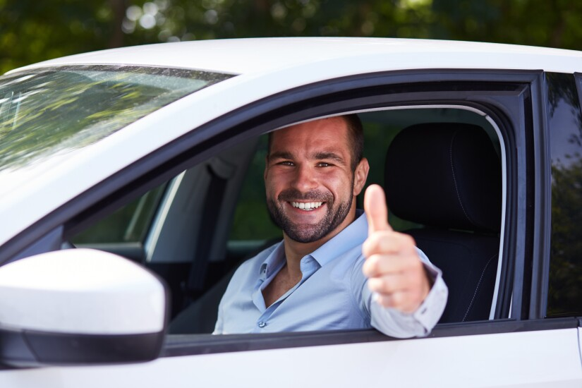 driver giving thumbs up