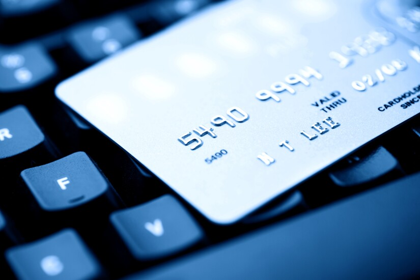 Credit card and computer keyboard